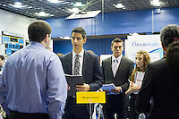 Job seekers attend a job fair at Pace University in New York on Thursday, September 20, 2012.  The US Labor Department reports new claims for unemployment benefits for last week were a seasonally adjusted 382,000. ( © Frances M. Roberts)