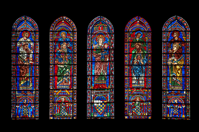 Medieval Window of the South Transept of the Gothic Cathedral of Chartres, France- Circa 1225-30. A UNESCO World Heritage Site. These windows were a donation of the Mauclerc family, the Counts of Dreux-Bretagne, who are depicted with their arms in the bases of the lancets above (centre) is the Virgin Mary & Child and on either side are the four evangelists sitting on the shoulders of four Prophets - a rare literal illustration of the theological principle that the New Testament builds upon the Old Testament.