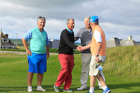 Arthur Pierse (Tipperary) being congratulated by Barry Redden after beating John-Ross Galbraith (Whitehead) 2&1 during Matchplay Round 2 of the South of Ireland Amateur Open Championship at LaHinch Golf Club on Friday 22nd July 2016.<br />