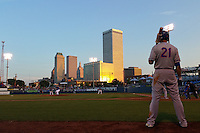 General view of Midland RockHounds first baseman Matt Olson (21) on deck with the skyline during a game against the Tulsa Drillers on June 2, 2015 at Oneok Field in Tulsa, Oklahoma.  Midland defeated Tulsa 6-5.  (Mike Janes/Four Seam Images)