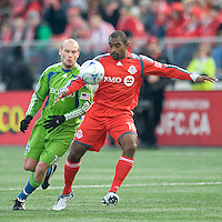Marvell Wynne (16) of Toronto FC attempts to clear a ball from Freddie Ljungberg (10) of the Seattle Sounders FC during MLS action at BMO Field on April 4, 2009.Seattle won 2-0.
