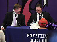 NWA Democrat-Gazette/J.T. WAMPLER Fayetteville boys basketball coach Kyle Adams (LEFT) smiles Wednesday April 10, 2019 after announcing his retirement after 37 years of coaching. Assistant coach Brad Stamps (RIGHT),was named as the new head coach at Fayetteville.