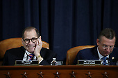 United States Representative Jerrold Nadler (Democrat of New York), Chairman, US House Judiciary Committee and US Representative Doug Collins (Republican of Georgia) look on before testimony by constitutional scholars before the US House Judiciary Committee in the Longworth House Office Building on Capitol Hill December 4, 2019 in Washington, DC. This is the first hearing held by the Judiciary Committee in the impeachment inquiry against U.S. President Donald Trump, whom House Democrats say held back military aid for Ukraine while demanding it investigate his political rivals. The Judiciary Committee will decide whether to draft official articles of impeachment against President Trump to be voted on by the full House of Representatives.<br /> Credit: Drew Angerer / Pool via CNP