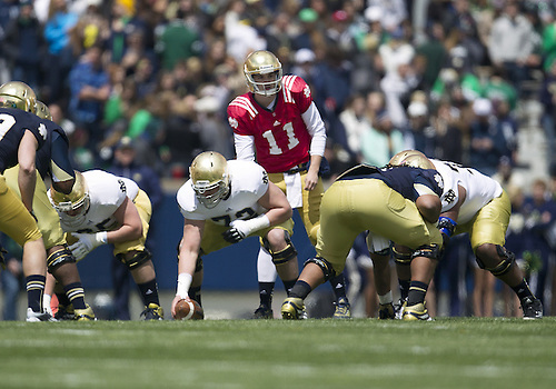 April 20, 2013:  Notre Dame Fighting Irish quarterback Tommy Rees (11) directs the offense during the Notre Dame Blue-Gold Spring game at Notre Dame Stadium in South Bend, Indiana.  The Defense topped the Offense by a score of 54-43.