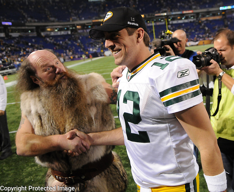 Green Bay Packers quarterback Aaron Rodgers is congratulated by Minnesota Vikings mascot Ragnar following a 31-3 win at the Hubert H. Humphrey Metrodome in Minneapolis, Minn. on Nov. 21, 2010.  Ragnar also invited Rodgers to go deer hunting on his property.