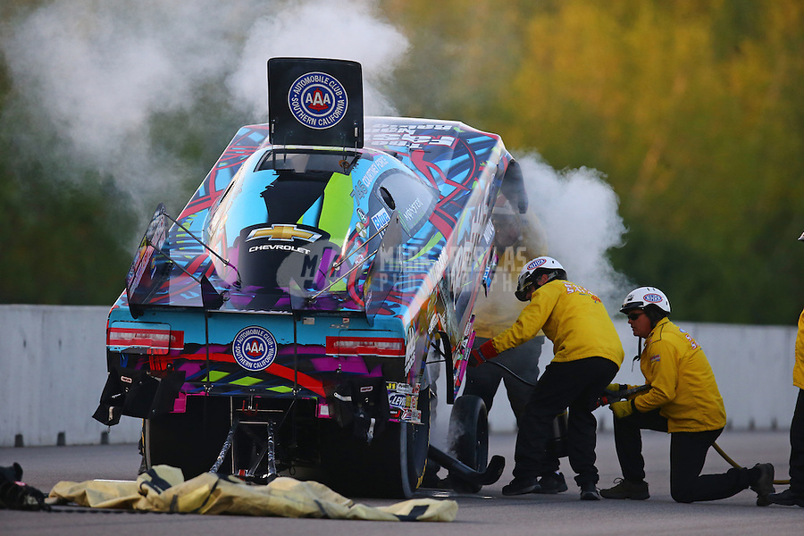 Jun 3, 2016; Epping , NH, USA; Smoke comes from the car of NHRA funny car driver Courtney Force as the safety safari crews extinguish a fire during qualifying for the New England Nationals at New England Dragway. Mandatory Credit: Mark J. Rebilas-USA TODAY Sports