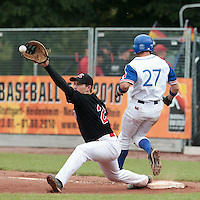 27 july 2010: Hans Heyrman of Belgium catches the ball as Joris Bert of France is safe during France 8-2 victory over Belgium, in day 5 of the 2010 European Championship Seniors, in Stuttgart, Germany.