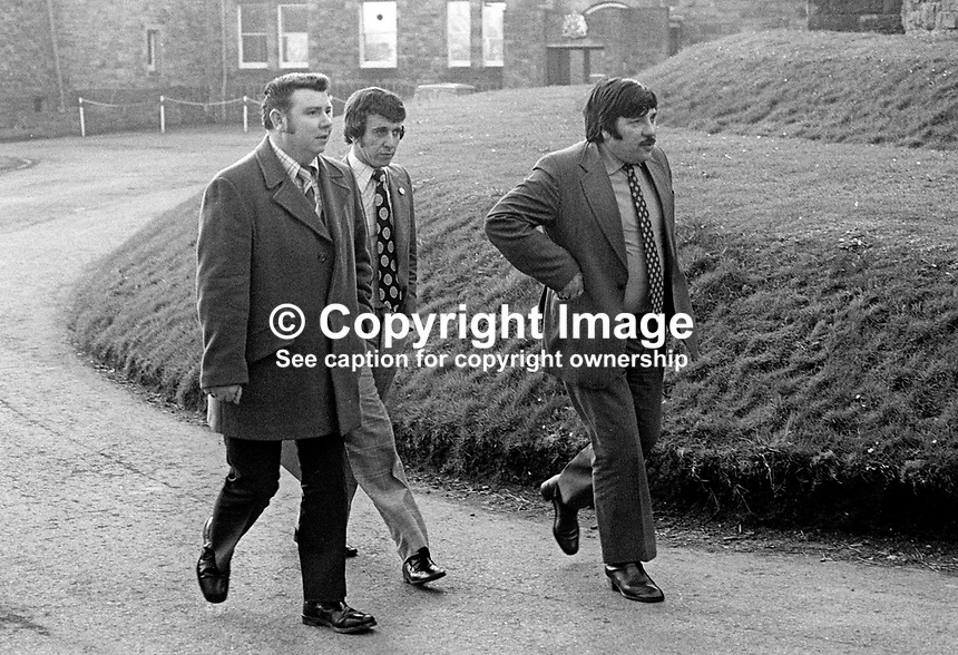 Leading members of the UDA, Ulster Defence Association, leave Stormont Castle, Belfast, N Ireland, after a meeting to discuss the organisation's offer to provide local policing. Left to right: Sam McCormack, John Orchin and Andy Tyrie. 27th February 1975. 197502270164a<br />