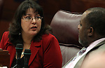 Nevada Assembly Democrats Irene Bustamante Adams and Jason Frierson talk on the Assembly floor Monday, April 25, 2011, at the Legislature in Carson City, Nev. .Photo by Cathleen Allison