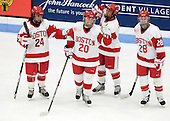 Taylor Holze (BU - 24), Isabel Menard (BU - 20), Kasey Boucher (BU - 3), Louise Warren (BU - 28) - The Boston University Terriers defeated the visiting University of Connecticut Huskies 4-2 on Saturday, November 19, 2011, at Walter Brown Arena in Boston, Massachusetts.