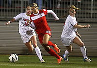 BOYDS, MARYLAND - April 06, 2013:  Stephanie Ochs (22) of The Washington Spirit breaks away from Shasta Fisher (12) of the University of Virginia women's soccer team in a NWSL (National Women's Soccer League) pre season exhibition game at Maryland Soccerplex in Boyds, Maryland on April 06. Virginia won 6-3.