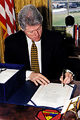 United States President Bill Clinton signs the National Defense Authorization Act for Fiscal Year 1996 in the Oval Office of the White House in Washington, DC on February 10, 1996.<br /> Mandatory Credit: Robert McNeely / White House via CNP