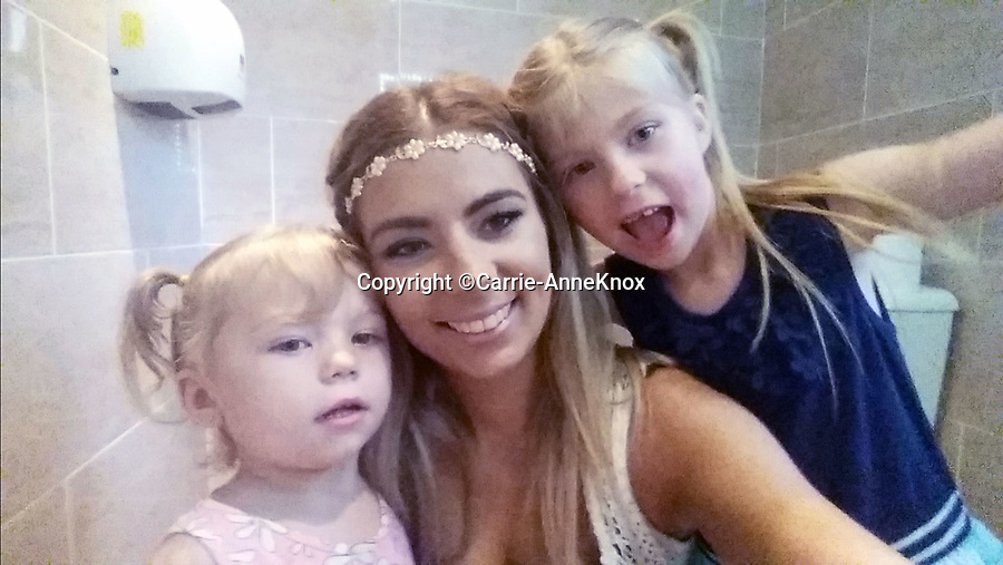 BNPS.co.uk (01202 558833)<br /> Pic:  Carrie-AnneKnox/BNPS<br /> <br /> Carrie-Anne with daughters Adriannah(6) and Elsie(2). <br /> <br /> A woman today told of a first date from hell that ended with her being seriously injured, suffering post-traumatic stress, losing her job and her admirer going to jail.<br /> <br /> Carrie-Anne Knox, from Bournemouth, was left lying unconscious and suffering a badly broken arm by Bradley Van Outen who ran away after crashing his car on their date.<br /> <br /> She is still recovering from her injuries eight months later and has lost her job as a hairdresser as a result. Van Outen has been jailed for driving offences.