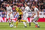 Julian Weigl (l) of Borussia Dortmund battles for the ball with Luka Modric and Lucas Vazquez of Real Madrid during the 2016-17 UEFA Champions League match between Real Madrid and Borussia Dortmund at the Santiago Bernabeu Stadium on 07 December 2016 in Madrid, Spain. Photo by Diego Gonzalez Souto / Power Sport Images