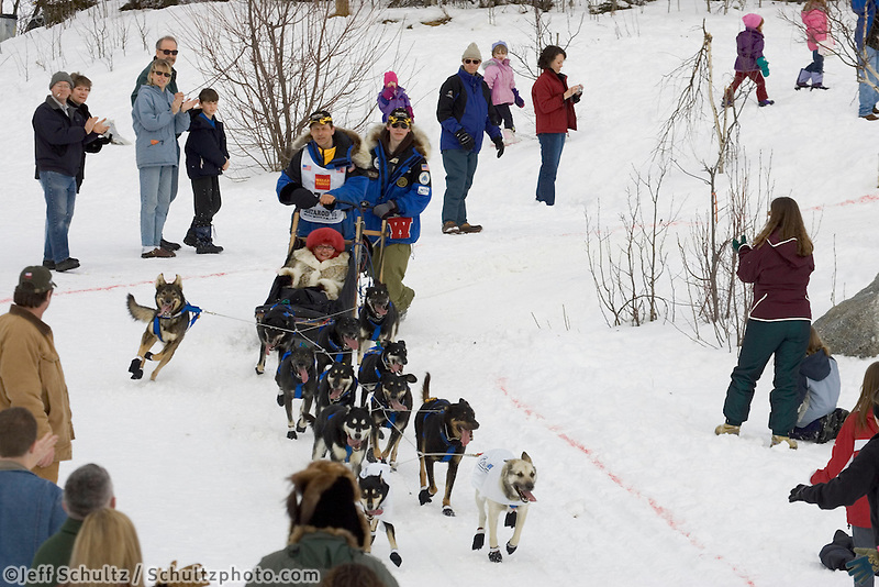 Martin Buser Gives High 5's on Trail Iditarod 2005 Ceremonial Start Midtown Anchorage AK