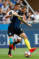 Calcio, Serie A: Inter vs Juventus. Milano, stadio San Siro, 18 settembre 2016.<br /> Inter's Davide Santon, right, is challenged by Juventus&rsquo; Paulo Dybala during the Italian Serie A football match between FC Inter and Juventus at Milan's San Siro stadium, 18 September 2016.<br /> UPDATE IMAGES PRESS/Isabella Bonotto