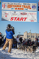 Peter Kaiser and team leave the ceremonial start line at 4th Avenue and D street in downtown Anchorage during the 2014 Iditarod race.<br /> Photo by Jim R. Kohl/IditarodPhotos.com