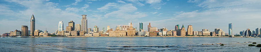 The Shanghai Bund, China.  From left: Butterfiled & Swire Building, Messageries Maritimes, Gutzaff Signal Tower, Asiatic Petroleum Building, Shanghai Club, Union Building, NKK Building, Russell & Co Building, Great Northern Telegraph Building, China Merchants Building, HSBC, Custom House, Bank of Communications, (new building), Russo-Chinese Bank (under restoration), Bank of Taiwan, North-China Daily News, Chartered Bank, Palace Hotel, Sassoon House & Cathay Hotel, Bank of China, Yokohama Specie Bank, Yangtze Insurance Building, Ewo Building, Glen Line Building, Banque de L'Indo-Chine, (Peninsula Hotel), HBMC (behind trees), Garden Bridge over the Soochow Creek, Broadway Mansion, Russian Consulate and the Astor House Hotel.  An eleven-image panorama.