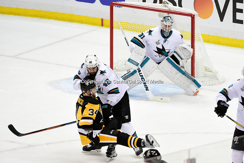 Thursday, June 9, 2016: San Jose Sharks defenseman Roman Polak (46) knocks Pittsburgh Penguins right wing Tom Kuhnhackl (34) off his feet during game 5 of the NHL Stanley Cup Finals  between the San Jose Sharks and the Pittsburgh Penguins held at the CONSOL Energy Center in Pittsburgh Pennsylvania. The Sharks defeat the Penguins 4-2 in regulation time. The Penguins lead the best of seven series 3-2. Eric Canha/CSM