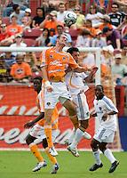 LA Galaxy defender Ante Jazic (4) and Houston Dynamo midfielder Nate Jaqua (21) battle for a header. The LA Galaxy defeated the Houston Dynamo 2-1  in a regular season MLS match at Robertson Stadium in Houston, TX on October 7, 2007.