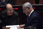 Israeli Prime Minister Benjamin Netanyahu (R) is seen speaking with MK Likud member and Former Israeli army Chief of Staff, Moshe (Boogie) Yaalon (L)  during a no-Confidence in Israel's Parliament (Knesset) in Jerusalem, June 15, 2009. Yesterday Netanyahu gave his much anticipated policy speech at Bar-Ilan University, which angered many on the Palestinian side but received luke-warm acceptance from the United States. Photo By: Tess Scheflan / JINI .