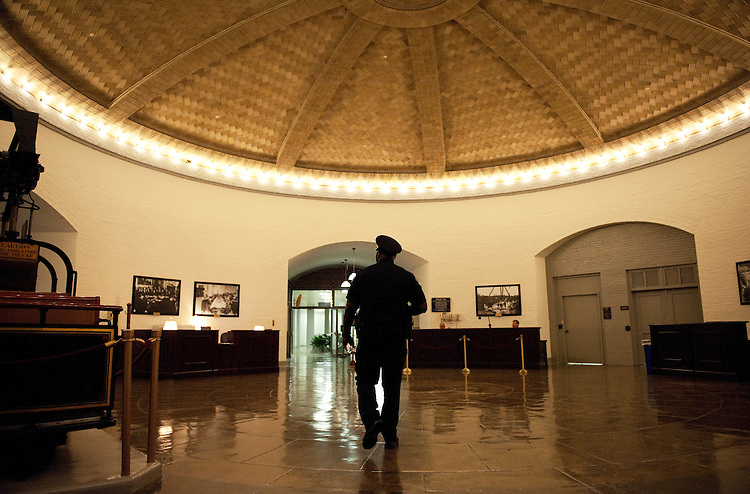 UNITED STATES - AUGUST 26:  A Capitol Police officer walks through the basement of Russell Building during the August Congressional recess.  (Photo By Tom Williams/Roll Call)