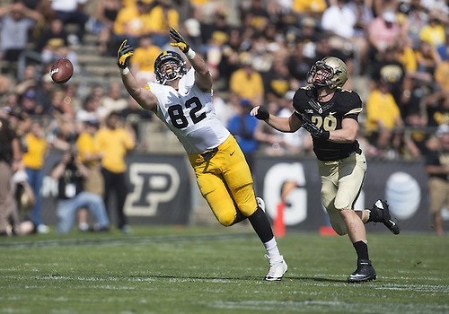 September 27, 2014:  Iowa tight end Ray Hamilton (82) attempts to make the catch as Purdue linebacker Jimmy Herman (29) defends during NCAA Football game action between the Iowa Hawkeyes and the Purdue Boilermakers at Ross-Ade Stadium in West Lafayette, Indiana. Iowa defeated Purdue 24-10.