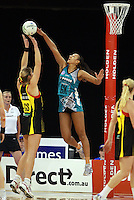 11.07.2010 Magic's Irene Van Dyk and Thunderbirds Geva Mentor in action during the ANZ Champs Final netball match between the Magic and Tunderbirds played at the Adelaide Entertainment Centre in Adelaide. ©MBPHOTO/Michael Bradley