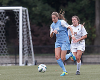University of North Carolina defender Megan Brigman (3) brings the ball forward as Boston College defender Madison Meehan (14) closes.  University of North Carolina (blue) defeated Boston College (white), 1-0, at Newton Campus Field, on October 13, 2013.
