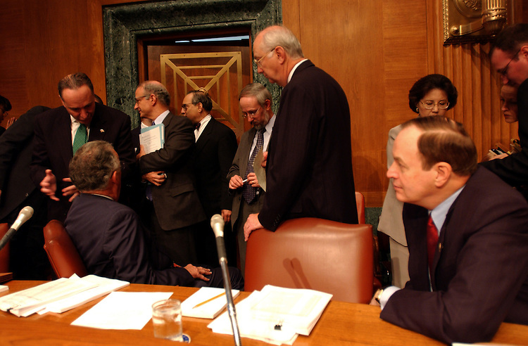 "5financing100401 -- Charles Schumer, D-N.Y., Paul S. Sarbanes, D-MD., Phil Gramm, R-Texas, and Richard Shelby R- Tenn., talk before the start of the full committee markup on ""The International Money Laundering Abatement and Anti-Terrorist Financing Act of 2001."""