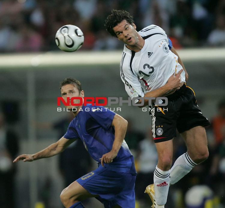 FIFA WM 2006 -  Semi Finals / Halbfinale<br /> Play    #61 (04-Juli) - Deutschland - Italien 0:2 n.V.<br /> <br /> Michael Ballack (rechts) von Deutschland Kopfball Sieger gegen Francesco Totti (links) von Italien.<br /> <br /> Foto &copy; nordphoto