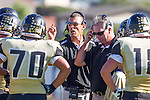 Palos Verdes, CA 09/27/13 - Michael Christensen (Peninsula Head Coach) and Doug Esparza (Peninsula Coach) in action during the Lawndale vs Palos Verdes Peninsula Varsity football game at Peninsula High School.