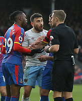 Crystal Palace's Aaron Wan-Bissaka and Luka Milivojevic have words with referee Craig Pawson along with West Ham United's Robert Snodgrass<br /> <br /> Photographer Rob Newell/CameraSport<br /> <br /> The Premier League - Saturday 9th February 2019  - Crystal Palace v West Ham United - Selhurst Park - London<br /> <br /> World Copyright © 2019 CameraSport. All rights reserved. 43 Linden Ave. Countesthorpe. Leicester. England. LE8 5PG - Tel: +44 (0) 116 277 4147 - admin@camerasport.com - www.camerasport.com