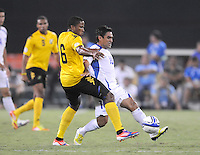 El Salvador midfielder Eliseo Quintanilla (10) goes against Jamaica defender Jermaine Taylor   Jamaica defeated El Salvador 2-0 in a international friendly match at RFK Stadium, Wednesday August 15, 2012.