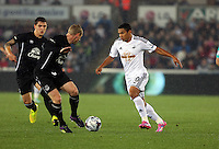 Pictured: Jefferson Montero of Swansea (R) against Tony Hibbert of Everton (2nd L). Tuesday 23 September 2014<br /> Re: Capital One Cup, Swansea City FC v Everton at the Liberty Stadium, south Wales, UK