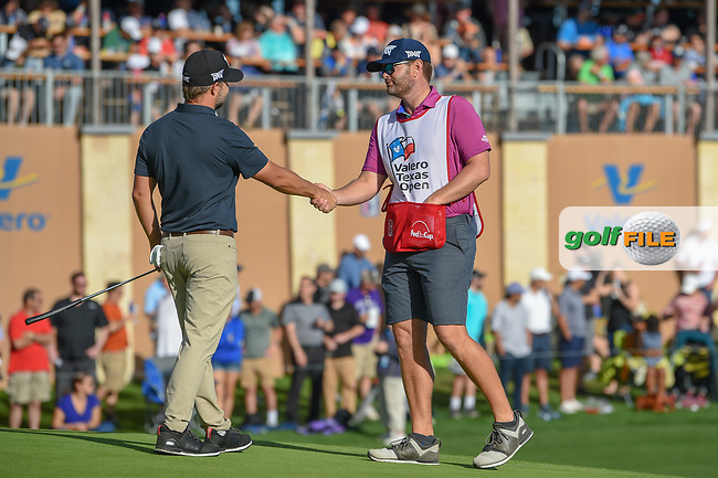 Ryan Moore (USA) shakes hands with his caddie on the green on 18 following day 4 of the Valero Texas Open, at the TPC San Antonio Oaks Course, San Antonio, Texas, USA. 4/7/2019.<br /> Picture: Golffile   Ken Murray<br /> <br /> <br /> All photo usage must carry mandatory copyright credit (© Golffile   Ken Murray)