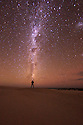 Man looking up at the milky Way at Sleaford Bay. Eyre Peninsula. South Australia.