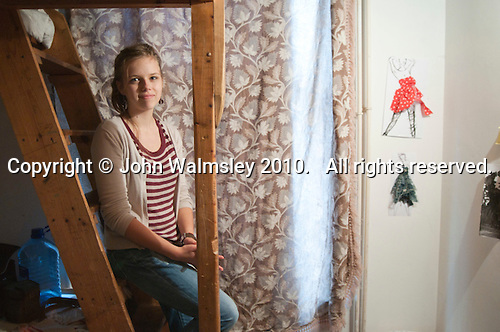 One of the students in her own room, Summerhill School, Leiston, Suffolk. The school was founded by A.S.Neill in 1921 and is run on democratic lines with each person, adult or child, having an equal say.  You don't have to go to lessons if you don't want to but could play all day.  It gets above average GCSE exam results.