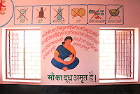 The walls of Anganwadi clinics are decorated with brightly painted murals and graphics, to appeal to children and convey vital healthcare messages to mothers who are often illiterate due to poor education.