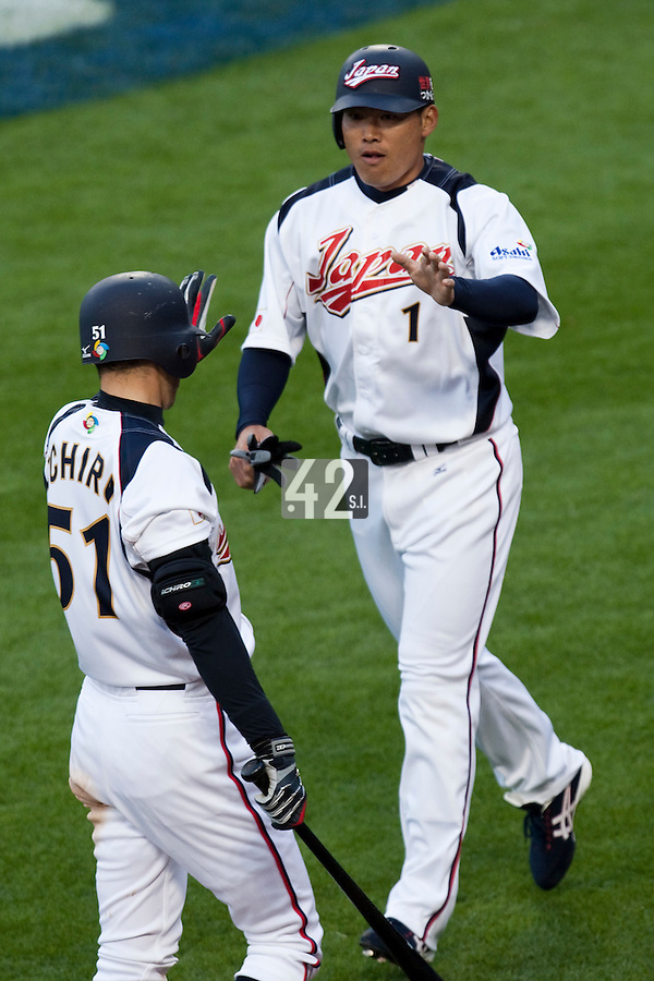 22 March 2009: #1 Kosuke Fukudome of Japan celebrates with #51 Ichiro Suzuki after scoring during the 2009 World Baseball Classic semifinal game at Dodger Stadium in Los Angeles, California, USA. Japan wins 9-4 over Team USA.