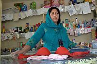 AFGHANISTAN, 06.2008, Kabul. Seltenheit: Frau als Verkaeuferin. Normalerweise haben nur Maenner Positionen inne, in denen es Kontakt zu beiden Geschlechtern gibt. Dieser Laden befindet sich in der für Frauen reservierten Zone der Hauptstadt.   Rare thing: Woman selling in the shop. Usually such position which involves contact with both sexes is reserved for men. This shop is in the women-only zone of the capital.<br /> © Marzena Hmielewicz/EST&OST