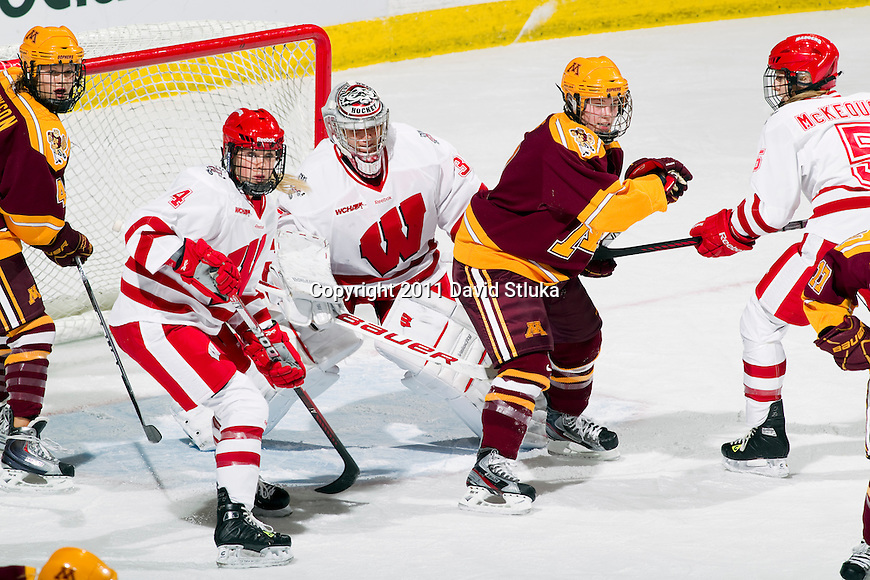 Wisconsin Badgers goalie Alex Rigsby (33) looks on during an NCAA women's hockey game against the Minnesota Golden Gophers on October 14, 2011 in Madison, Wisconsin. The Badgers won 3-2. (Photo by David Stluka)