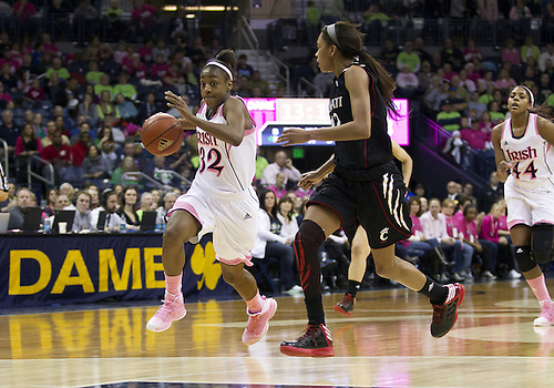 February 02, 2013:  Notre Dame guard Jewell Loyd (32) drives to the basket as Cincinnati guard Alyesha Lovett (12) defends during NCAA Basketball game action between the Notre Dame Fighting Irish and the Cincinnati Bearcats at Purcell Pavilion at the Joyce Center in South Bend, Indiana.  Notre Dame defeated Cincinnati 64-42.