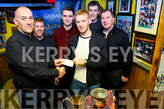 Kieran Doyle accepts a cheque from Aidan Roche on behalf of the Glenbeigh/Glencar team, the players raised funds themselves and this was matched by the Club. This was added to a substantial contribution from John Griffin and will be used for a well deserved Team Holiday in Prague in early January.<br /> L-R Aidan Roche, Pa Kilkenny, Sean Roche, Kieran Doyle, Colin O'Sullivan &amp; Timmy O'Sullivan.