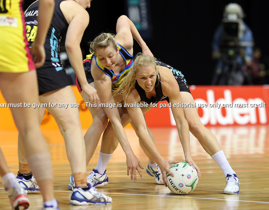 13.05.2013 Magic's Laura Langman and Pulse's Camilla Lees in action during the ANZ Champs netball match between the Magic and Pulse played at Claudelands Arena in Hamilton. Mandatory Photo Credit ©Michael Bradley.