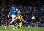 Montrose's John Crawford gets to the ball before Andy Little to divert the ball into his own net for an OG