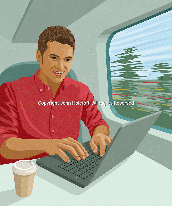 Young man working on laptop computer on train journey