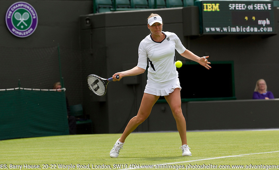 VERA ZVONEREVA (RUS) (2) against ALISON RISKE (USA) in the first round of the Ladies SIngles. Vera Zvonereva beat Alison Riske 6-0 3-6 6-3.  .Tennis - Grand Slam - Wimbledon - AELTC - London- Day 1 - Mon June 20th 2011..© AMN Images, Barry House, 20-22 Worple Road, London, SW19 4DH, UK..+44 208 947 0100.www.amnimages.photoshelter.com.www.advantagemedianetwork.com.