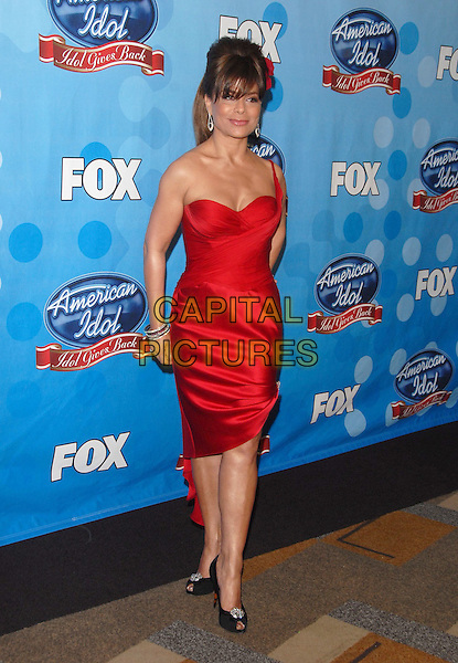 PAULA ABDUL.at The Idol Gives Back 2008 taping held at The Kodak Theatre in Hollywood, California, USA, April 06 2008..full length red dress one shoulder strap silk satin black Christian Louboutin shoes peep-toe silver disc bracelets .CAP/DVS.©Debbie VanStory/Capital Pictures