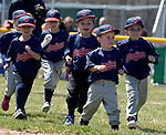 Pee wee players in the instructional team runs onto the field,   Saturday, April 21, 2018, during the opening day of Suffield little league. (Jim Michaud / Journal Inquirer)